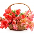 Stock Photo: Basket with colorful artificial flowers