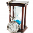 Hourglass and a pocket watch — Stock Photo