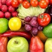 Bright background of vegetables and fruits — Stock Photo