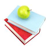 Livres et pomme verte — Photo