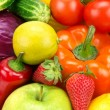 Bright background of different fruits and vegetables — Stock Photo