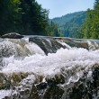 Waterfall on the river in the mountains — Stock Photo #27160395