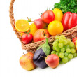 Fruits and vegetables in a wicker basket — Stock Photo