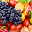 Bright background of bright fruit and vegetables — Stock Photo
