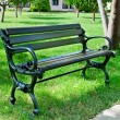Garden bench in a summer park — Stock Photo