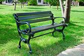 Garden bench in a summer park — Stock Photo