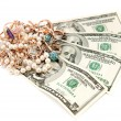 Gold ornaments and dollars isolated on a white background — Stock Photo