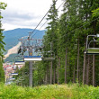 Chair lift in the mountains in summer — Stock Photo