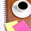 Stock Photo: Cup of coffee and office supplies