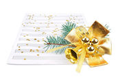 Christmas decorations and music sheet — Stock Photo