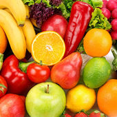 Bright background of ripe fruits and vegetables — Stock Photo