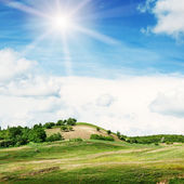 Mountainous terrain and the blue sky — Stock Photo