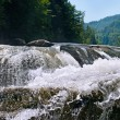 Waterfall on the river in the mountains — Stock Photo
