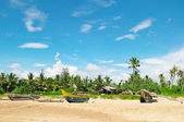 Fishing boats on a tropical beach — Photo