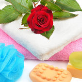 Towels, soap and sponges isolated on white background — Stock Photo