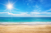 Seascape and sun on blue sky background — Stok fotoğraf