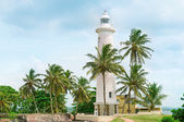 Lighthouse and palm trees in the town of Galle, Sri Lanka — Stockfoto