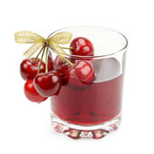 Cherry and glass of juice — Stock Photo