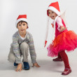 Boy and girl in Santa hats — Stock Photo