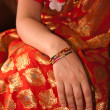 Orange Sari with Bangled wrist — Stock Photo #13634228