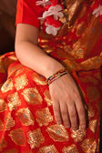 Orange Sari with Bangled wrist — Stock Photo