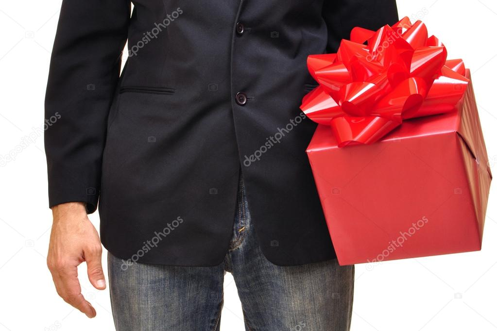 Closeup of unidentifiable man holding red gift with bow on white background — Stok fotoğraf #16647787
