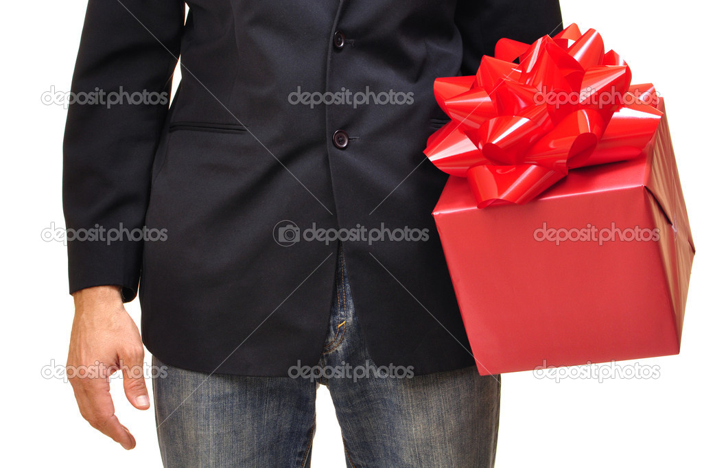 Closeup of unidentifiable man holding red gift with bow on white background — 图库照片 #16647787
