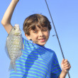 Young fisherman — Stock Photo #27014383
