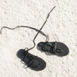 Sandals on sand — Stock Photo