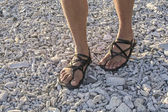 Walking in sandals on beach — Stock Photo