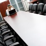 Portrait of entrepreneur in the boardroom — Stock Photo #10710813