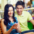 Couple with smart-phone — Stock Photo #10745115