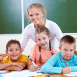 Stock Photo: Teacher and schoolkids