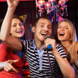 Stock Photo: Singing friends