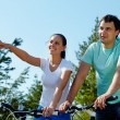 Couple on bicycles — Stock Photo #13723709
