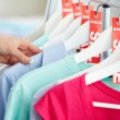 Stock Photo: Looking through clothes