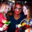 Girls and barman - Stock Photo