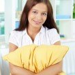 Girl with pillow — Stock Photo
