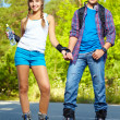 Stock Photo: Couple on roller skates