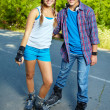 Couple of roller skaters - Stockfoto