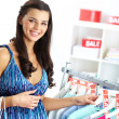 Shopper in clothing department — Stock Photo #13724787