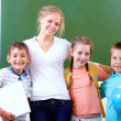Teacher and schoolkids — Foto Stock