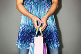 Shopper with paperbags — Stockfoto