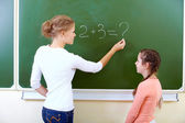 By the blackboard — Stock Photo