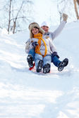 Tobogganing couple — Stock Photo