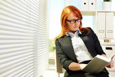 Reading in office — Stock Photo