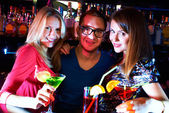 Girls and barman — Stock Photo