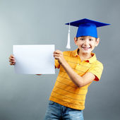Schoolboy with blank paper — Stock Photo
