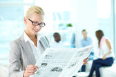Woman with newspaper — Stock Photo
