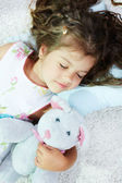 Sleeping with toy — Stock Photo